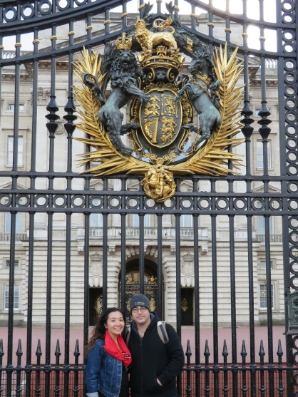 In front of the gates at Buckingham Palace.